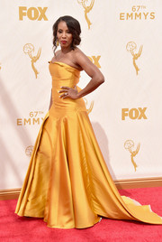 June Ambrose brought an ultra-glam pop to the Emmys red carpet with this yellow strapless gown by Bibhu Mohapatra.