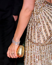Toni Collette paired her glimmering sequined gown with a gilded hard case clutch.