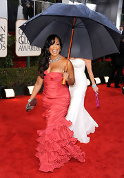 The rain doesn't stop Niecy's cheerful spirit, or her style! The starlet wore a hot pink ruffled evening gown to the Golden Globe Awards.