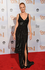 Heather goes glitzy at the Golden Globes in a sultry sequined gown with a thigh high slit.
