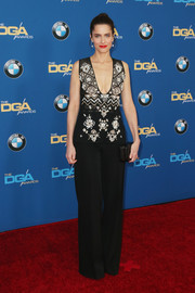 Amanda Peet opted for a pair of black wide-leg pants to complete her look.