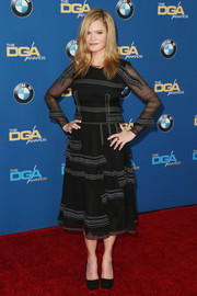 Jennifer Jason Leigh chose a Burberry Prorsum luggage-stich LBD for the Directors Guild of America Awards.