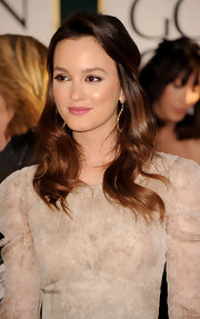 Leighton Meester paired her nude gown with a shiny half up hairstyle. Natural makeup and mauve lips completed her look.