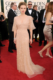 Scarlett donned a shimmering tulle evening dress with tiny rosettes.