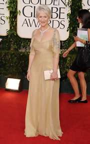 Helen Mirren looked perfectly sophisticated in a gold Badgley Mischka gown with crystal adorned drop sleeves.
