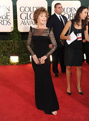 Jane wore an elegant black evening dress with dramatic shoulders and sparkling sleeves.