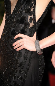Jayma Mays balanced her beaded gown with a chunky gunmetal bangle.