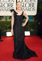 Piper looked classically beautiful with her red lips and a floor sweeping black evening gown.