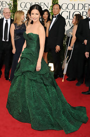 Catherine Zeta Jones stunned in an emerald ruffled Monique Lhuillier gown. The dramatic strapless dress was a perfect choice for the striking star.