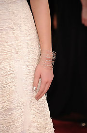 Hailee Steinfeld paired her white gown with an ornate silver bangle.