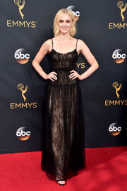 Sophie Turner looked simply lovely in a sheer black lace dress by Valentino, which she wore with a nude underlay, during the Emmy Awards.