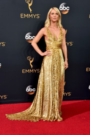 Claire Danes WOWED in a shimmering gold fishtail gown by Schiaparelli at the Emmys.