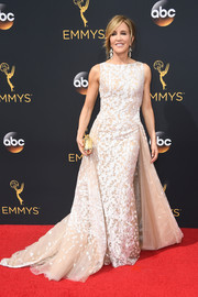 Felicity Huffman looked downright regal at the Emmys in an embroidered white and nude fishtail gown by Tony Ward.