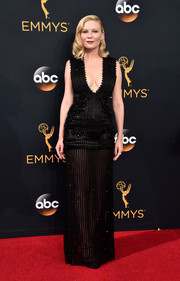 Kirsten Dunst was all about sultry glamour at the Emmys in a beaded black Givenchy Couture gown with a plunging neckline and a see-through skirt.
