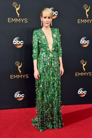 Sarah Paulson looked fiercely glam at the Emmys in a plunging Prada gown, rendered in green sequins and clustered gold beading.
