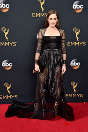 Carly Chaikin flashed plenty of skin in a sheer black lace and Swiss-dot gown at the Emmy Awards.