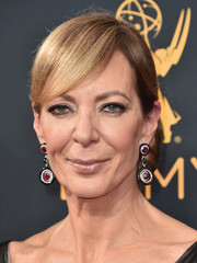 Allison Janney opted for a classic chignon with side-swept bangs when she attended the Emmys.