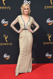 Judith Light exuded elegance at the Emmys in a plunging nude gown with silver beading.