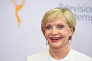 Actress Florence Henderson arrives on the red carpet for the 68th Los Angeles Emmy Awards featuring Niecy Nash, Jason George, Mary Holland, Florence Henderson and Larry King in North Hollywood, California, on July 23, 2016. .  / AFP / Angela WEISS