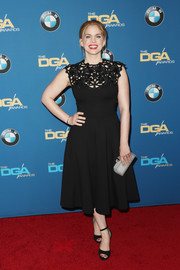 Anna Chlumsky complemented her dress with black ankle-strap peep-toes by Via Spiga.