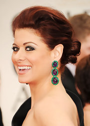 Debra Messing wore her curly tresses swept back into a low classic bun at the 69th Annual Golden Globe Awards.