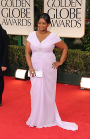 Octavia Spencer wore a lilac chiffon v-neck gown to the Golden Globes.