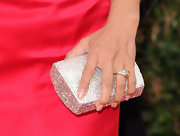 Jeannie Mai amped up the sparkle with this bedazzled clutch at the Golden Globe Awards.