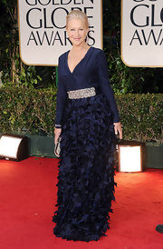 Helen Mirren looked fabu in a navy evening dress with a bejeweled waistline and skirt textured with petals.