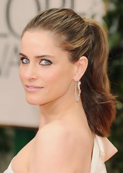 Amanda Peet wore a pair of platinum snake hoop earrings at the 69th Annual Golden Globe Awards.