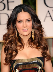 Salma Hayek attended the 69th Annual Golden Globe Awards with her long locks in tousled curls.