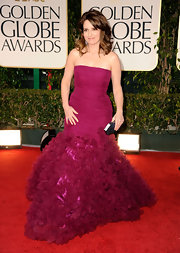 Tina Fey wore a luxe cranberry gown to the Golden Globe Awards.