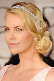 Charlize Theron wore her blond tresses in a loose side-swept updo at the 69th Annual Golden Globe Awards.