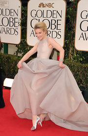 "Piper Perabo added a touch of shine to her Golden Globes gown with silver ""Poseidon"" pumps."