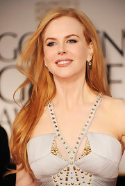 Nicole Kidman wore a pair of 5-carat old European-cut diamond pendant earrings at the 69th Annual Golden Globe Awards.