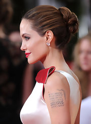 Angelina Jolie wore her hair in a sleek bobby-pinned updo at the 69th Annual Golden Globe Awards.