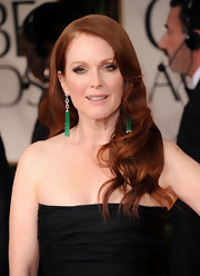 Julianne Moore wore a pair of diamond and emerald bead tassel earrings at the 69th Annual Golden Globe Awards.