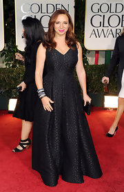 Maya Rudolph wore a classic black gown with snakeskin embossing for the Golden Globes.