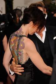 Kate Mestitz showed off her colorful back piece at the 69th Annual Golden Globe Awards.