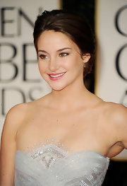 Shailene Woodley wore her hair swept back into a low bun at the 69th Annual Golden Globe Awards.