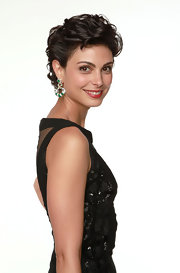 Morena Baccarin wore a pair of cab emerald, sapphire and diamond dangle earrings at the 69th Annual Golden Globe Awards.