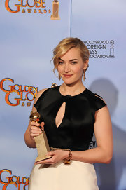 Kate Winslet attended the 69th Annual Golden Globes wearing a 1940s citrine and 18-carat gold cuff bracelet.