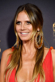 Heidi Klum punched up her look with an oversized pair of wood and diamond hoops by Lorraine Schwartz.