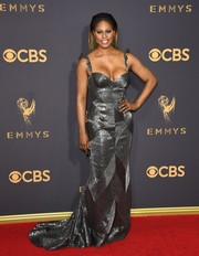 Laverne Cox went for vampy glamour in a low-cut beaded gunmetal gown by Naeem Khan at the 2017 Emmys.
