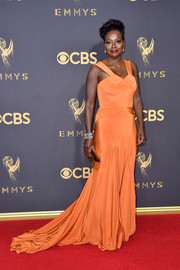 Viola Davis kept it classic in an orange fishtail gown by Zac Posen at the 2017 Emmys.
