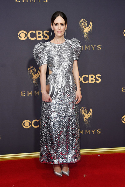 Sarah Paulson amped up the shine with a mirrored silver clutch by Lee Savage.