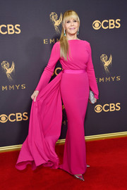 Jane Fonda brought a dazzling pop of color to the Emmys red carpet with this fuchsia column dress by Brandon Maxwell.