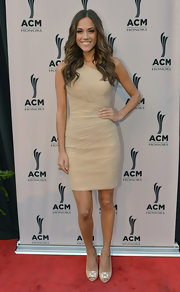 Jana Kramer wowed on the red carpet at the 6th Annual ACM Honors wearing a nude one-shoulder knee-length dress.