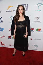 Katherine Langford balanced out her sultry top and skirt with a menswear-chic jacket.