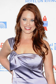 Melissa stood out on the red carpet with her vibrant red hair and bright blue eyes. Her hair was side-parted and loosely curled.