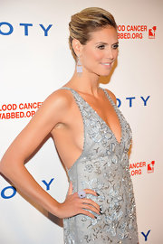 Heidi Klum stuck with cool silvery shades and swept on a deep gunmetal gray lacquer.